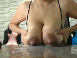 Big Breasted Lactating Latina Babe Squirts Milk and Sucks Own Boobs